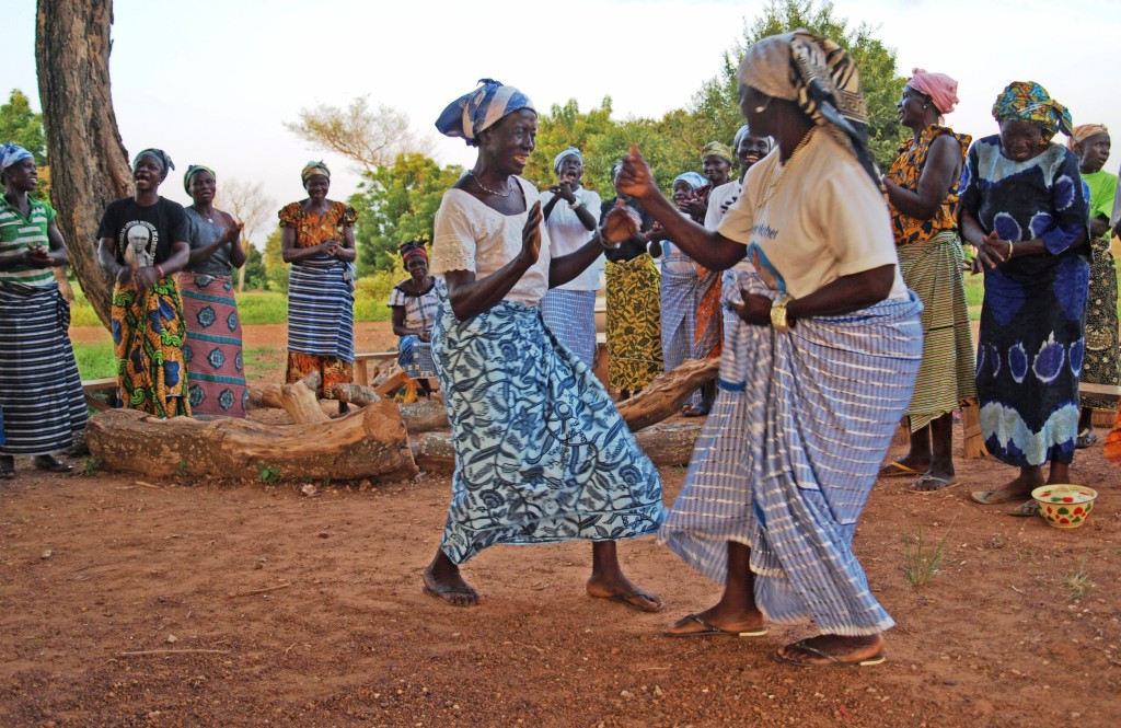 women in Gbengbee sing and dance to close the meeting. Photo by Kaitlyn Criddle.